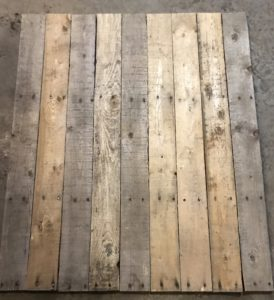 Lay out your cut pallet boards on a flat surface
