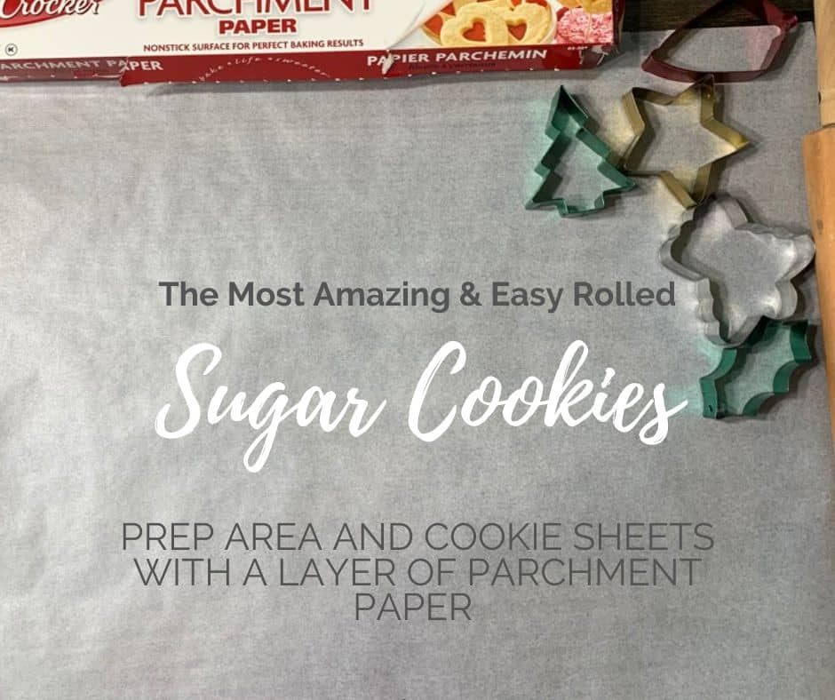Prepare area and cookie sheets by laying out parchment paper and lightly dusting with flour to make rolling and cutting the sugar cookies easier!